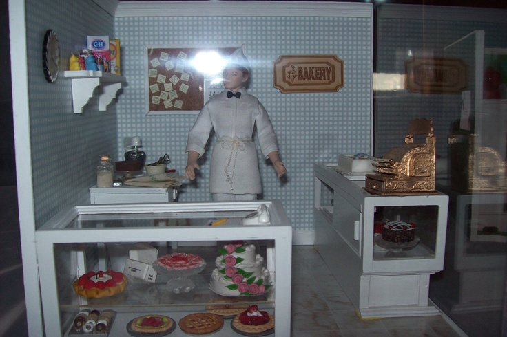 Bakery made with lots of cakes purchased at the Hobby Lobby Warehouse outlet.  He is busy making a cake on the back countertop.