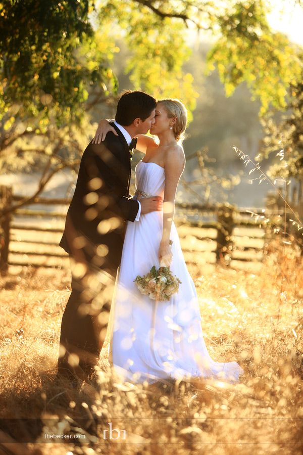 Gorgeous photo of the bride & groom kissing