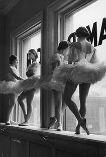 NEW YORK CITY, 1936 -- Ballerinas stand on a window sill in a rehearsal room at George Balanchine's School of American Ballet.
