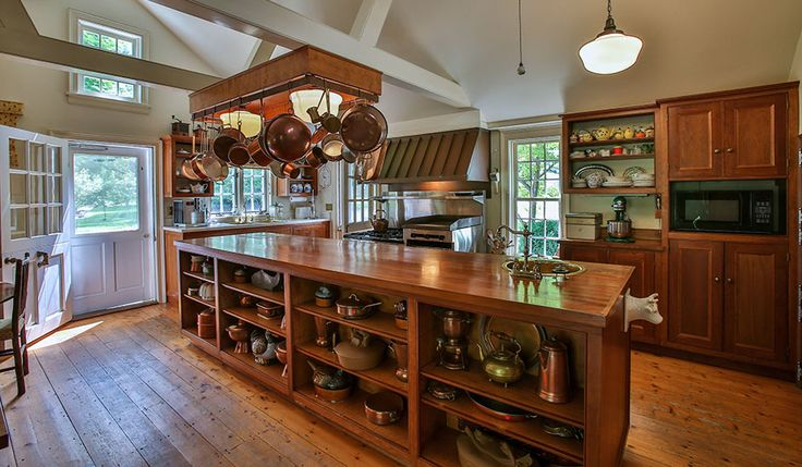 The Outstanding Farmhouse Kitchen Features A 12 Foot Island With Wood Countertop And Small