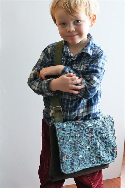 This messenger bag unfolds into a play mat & toys/cars!!!  Too cool!!  You can even stuff in their jammies & toothbrush for a night over at Grandmas!