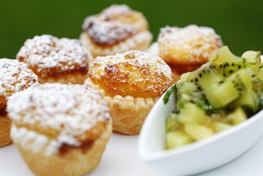 Little Coconut Tarts With Gold And Green Kiwifruit Salad  http://www.ruthpretty.co.nz/recipes.aspx/Pastry-Pies-Tarts/little-coconut-tarts