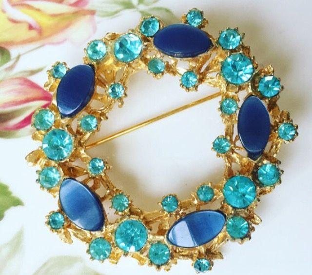 Beautiful blue stone vintage brooch listed in our Etsy shop.