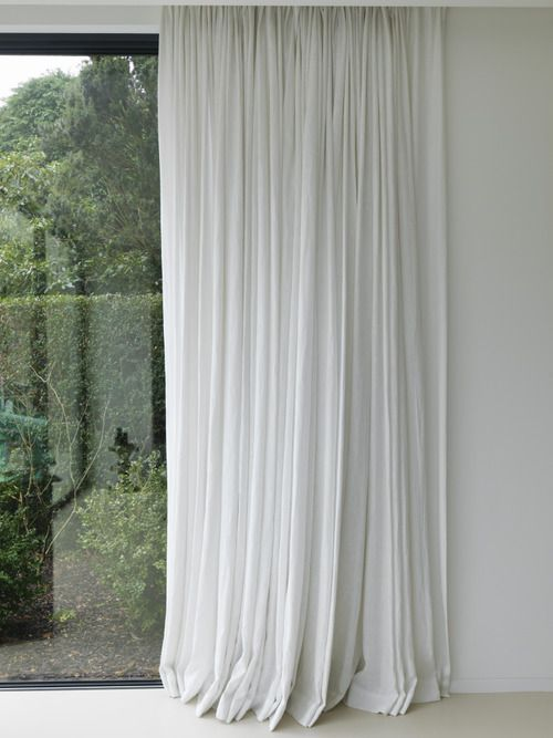 white curtains, white walls