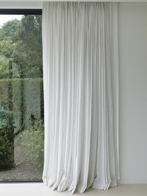 white curtains, white walls