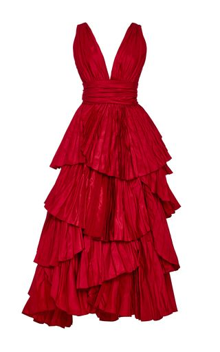 This sleeveless silk crepe **Marchesa** cocktail dress features a gathered neckline with draped rose detail at shoulder, peplum waist, and a slim-fit knee-length skirt with side slit accent.