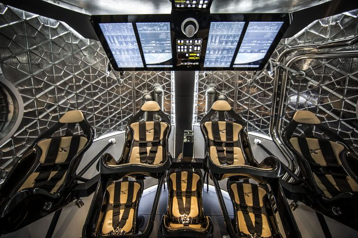 This wide shot of Dragon Version 2's interior shows the futuristic display screen and leather-lined seats. Image released May 29, 2014.