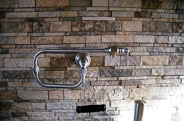 Stone Backsplash tips: typically you can get 3-5 years out of one coat before you have to reseal the stone. Many popular types of kitchen stone (including granite, marble, slate and limestone) absorb oil and water, so when the time comes to reseal, it's best to find an oil-repellant sealer. Also use natural sopas or neutral ph detergents when cleaning your stone backsplash. http://www2.dupont.com/Stone_Care/en_US/applications/usingprod_pgs/faqs.html