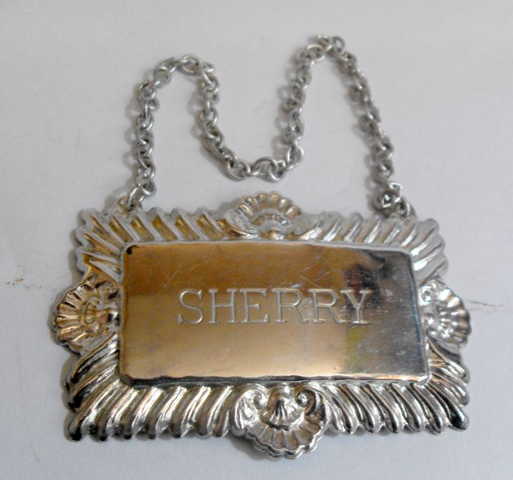 11381 £16 inc UK Post. Offers welcome. Silver plated sherry bottle or decanter label