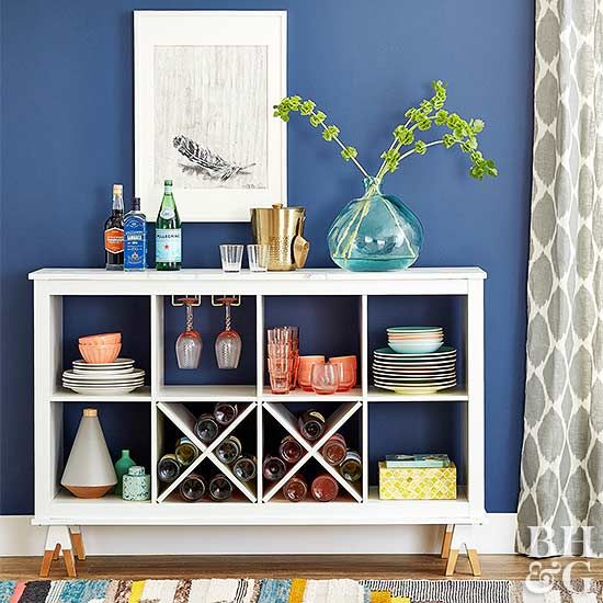 A basic cube shelving unit is the perfect piece of furniture to artfully display dishes and drinkware.