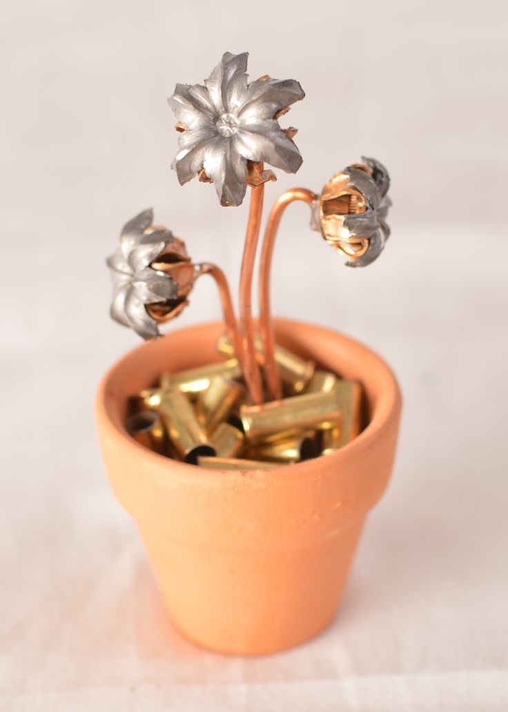 "Bullet Bouquets makes tiny flowerpots with ""flowers"" from fired and recovered hollow point bullets.  The flowerpots come in a variety of sizes, from 3 to 20 blooms in each.  Proudly handmade in the USA! Click here to learn more: http://bulletbouquets.com/"