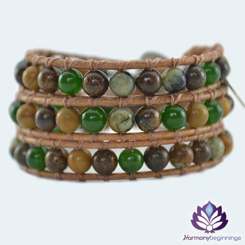 """Our <em><span style=""""color: #5328ad;"""">Gaia</span></em> wrap bracelet is designed with a combination of Bronzite, Green Jade and African Turquoise Gemstones. The natural vibrations of these stones will ground you and connect you to Gaia (Mother Earth), and your deepest inner self. Promoting balance, success and harmony in your life. On distressed tan leather (or vegan alternative*), finished with a unique silver button clasp. Can be purchased in two optional sizes for men or women, 2 ..."""