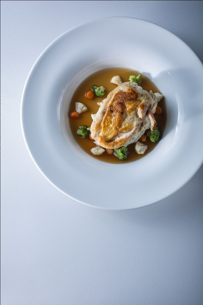 French crispy-skin chicken breast with fennel flavored creamy mashed potato and vegetable fond
