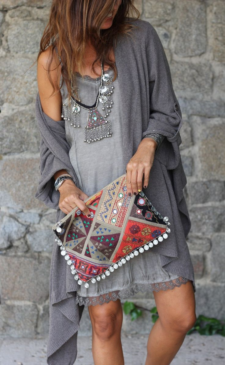 Love the total BOHO appeal of this outfit especially the over-the-top bib & clutch.
