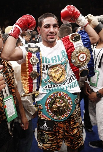 Danny Garcia  ( Eric Jamison / Associated Press / July 14, 2012 )  Danny Garcia improved to 24-0 with 15 knockouts after his fourth-round TKO of Amir Khan on Saturday night.