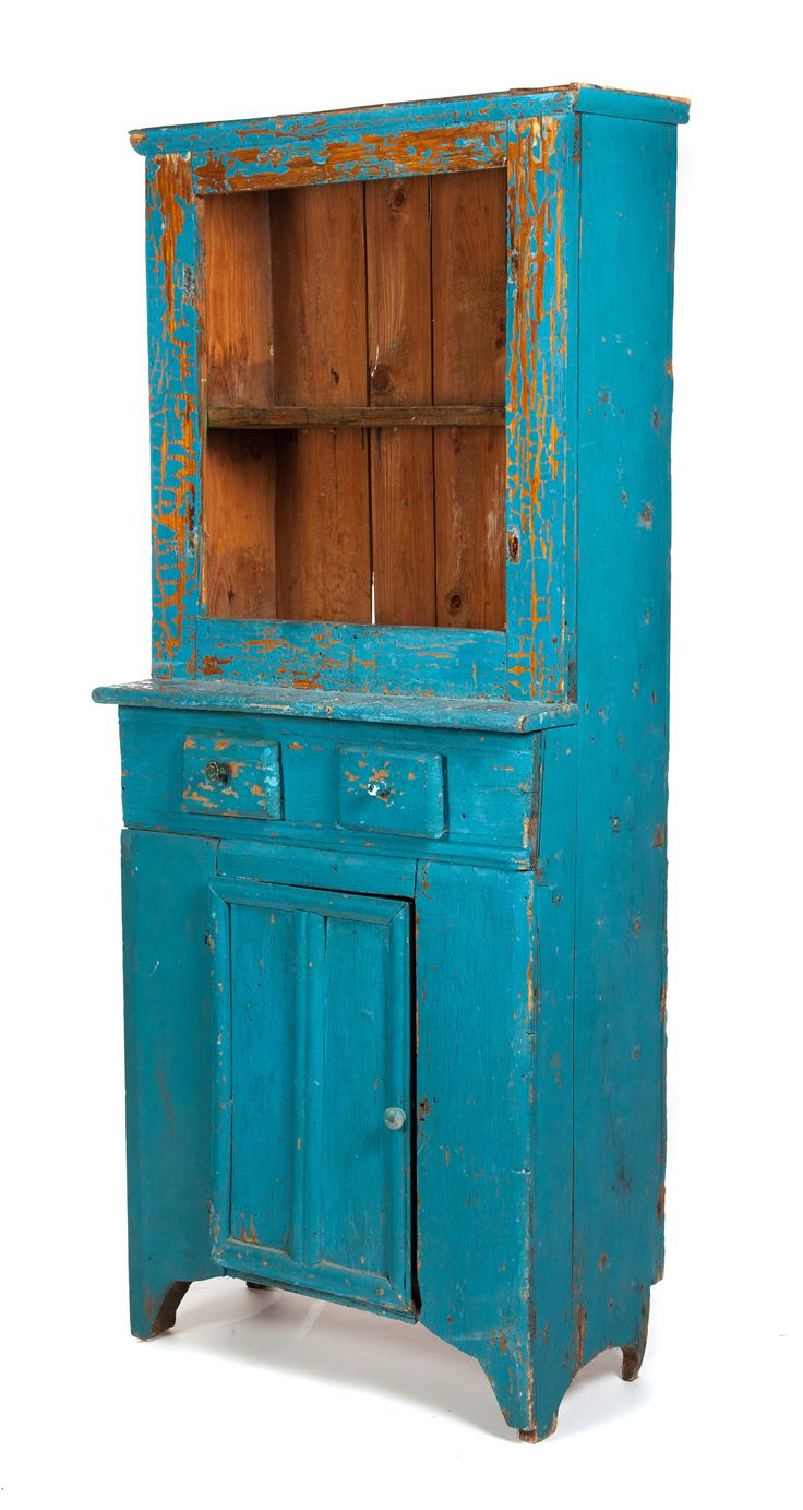 "Garths | Full Details for Lot 153 ONE-PIECE COUNTRY STEPBACK CUPBOARD. American, ca. 1900, pine. Heavy blue paint, open top, two waist drawers, lower door, and simple cutout feet. Found in Medina, Ohio. 73""h. 31""w. 16""d. Estimate $ 150-250"