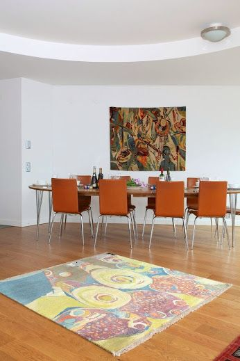 "Ehi Obinyan's rugs ""Eyo Festival"" and ""Market Scene""provide the right setting for the dining area. #rug #homedecor #interiordesign Check out our website for more of our collection http://ow.ly/KhPvX #rug #africanart #interiordesign"