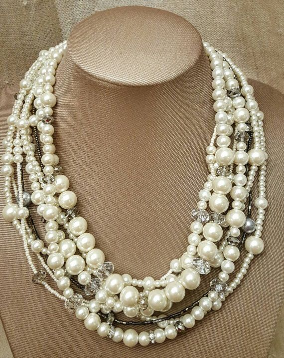 Check out this item in my Etsy shop https://www.etsy.com/ca/listing/476865283/chunky-pearl-and-crystal-multistrand