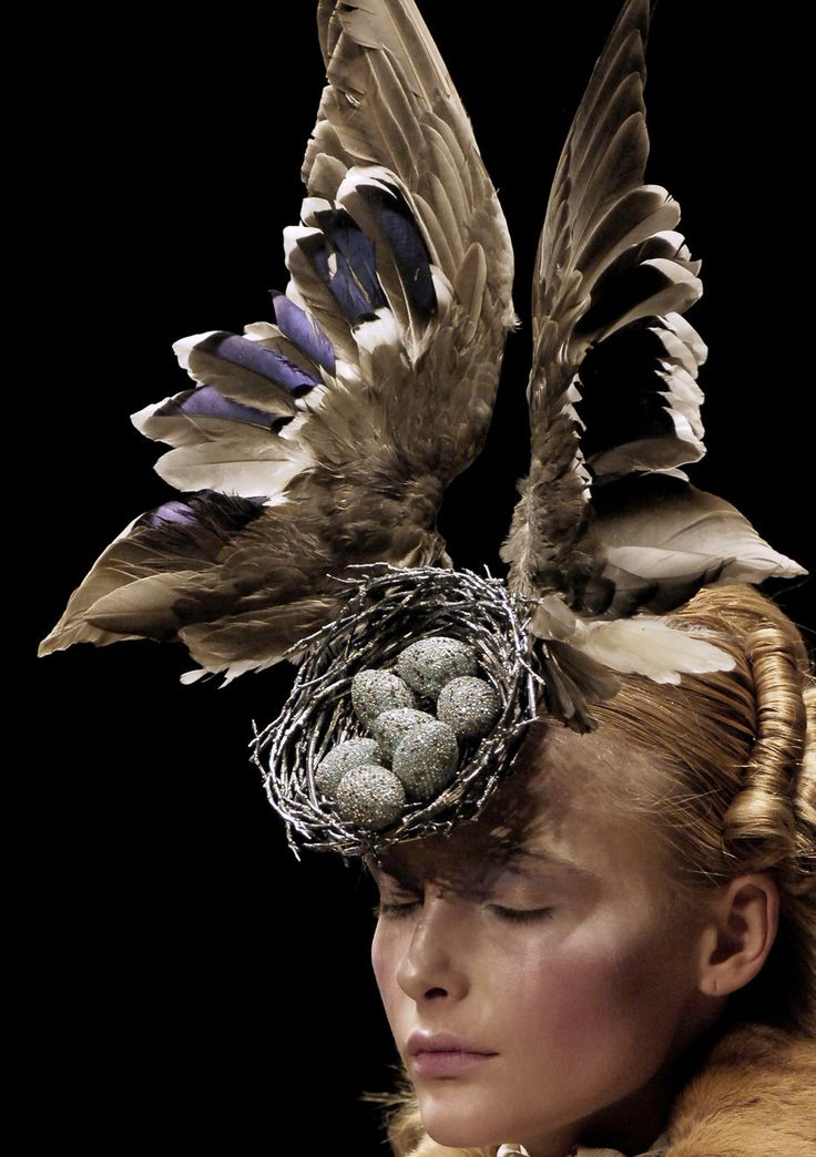 Snejana Onopka at Alexander McQueen Autumn/Winter 2006, wearing a Philip Tracey taxidermy head piece. The nest and eggs are encrusted with Swarovski Crystals.