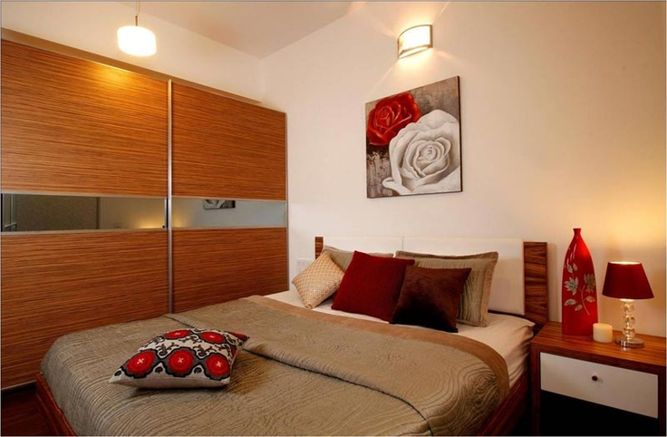 Master bedroom with sliding wardrobe-    SAVIO and RUPA Interior Concepts Bangalore | professional apartment interior designers Bangalore | Modern villa Interior Designers | Residential Interior Designs