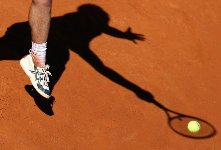 Richard Gasquet of France hits a return to Grigor Dimitrov of Bulgaria during their mens singles match at the Rome Masters tennis tournament Alessandro Bianchi/Reuters