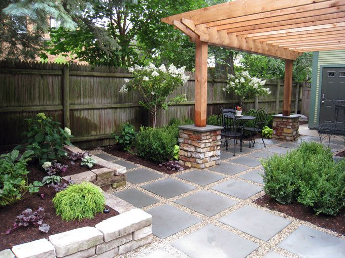 GardenScape - BackYard Features / Large bluestone pavers set in gravel can be used as a walkway or for additional seating areas under the partial shade of a cedar pergola