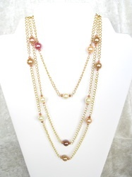 """Gorgeous, 60"""" long gold tone chain accented by bronze tone 10 mm pearls. Wrap, wrap, wrap! $55"""