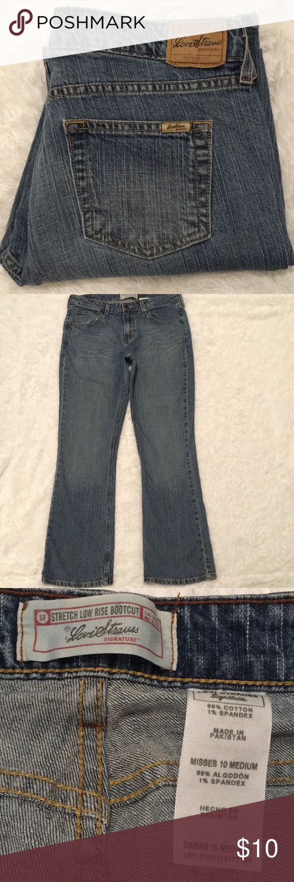 "Levi Strauss Sz 10M Low Rise Blue Jean Pants Signature Levi Strauss Stretch Low Rise Bootcut Jean Pants 5-Pocket  Zip up fly Button Closure  Distressed on back Leg (see pic)  Waist 16.5"" Front Rise 10"" Inseam 30.5"" Please see all pictures Signature by Levi Strauss Jeans Boot Cut"