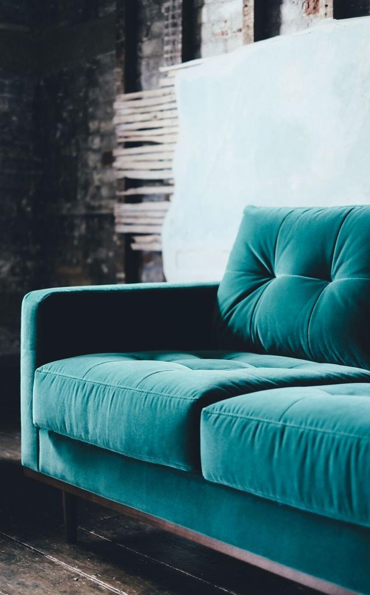 The Berlin three-seater sofa in kingfisher velvet. Where beauty and structure come together, the Berlin sofa is a classic mid-century design comprised of striking lines and buttonless tufting that set it apart as a unique living room centrepiece.