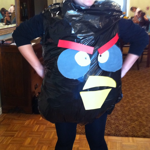 Angry bird costume from trash bag and paper and tape