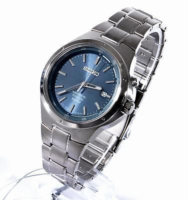 Seiko Core Mens Gray Brushed Titanium Kinetic Blue Dial Classic Watch SKA729