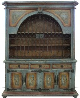 This Traditional Eclectic Bookcase Teal is a custom made piece that was created in Peru using reclaimed and repurposed woods and raw materials. Its strong masculine build is decorated with ornate hand forged iron hardware and painted in with drab primary colors to give the design a complementary contrast.