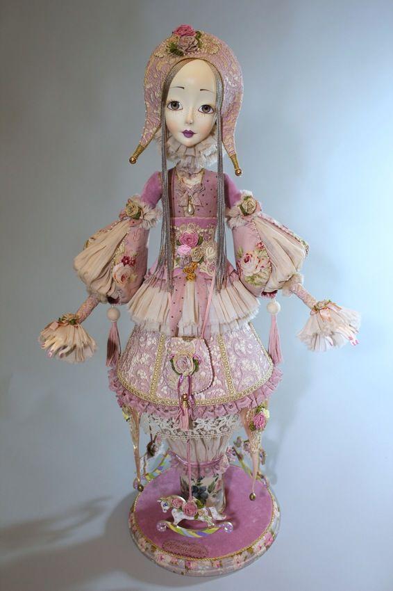 Цветочная карусель -механическая кукла.
