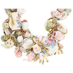 Tom Binns for Disney Alice in Wonderland ~ That is an impressive charm bracelet! I wonder how heavy it is.