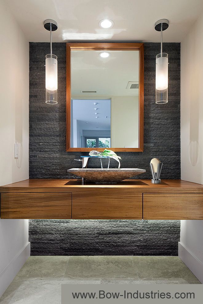 Washroom with natural stone back wall and wooden accents