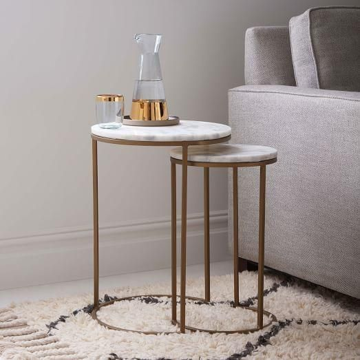Tables - For a touch of Art Deco glam, we finished the sculptural metal bases of our Round Nesting Tables with smooth white marble tabletops. Scaled for smaller spaces, its nesting function lets you hide the smaller table under the larger one, and pull it out when you need more surface space.