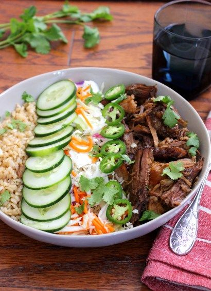 Bahn mi brown rice bowls filled with sweet and sour asian pulled pork served over hot brown rice and topped with tangy and zippy asian coleslaw.