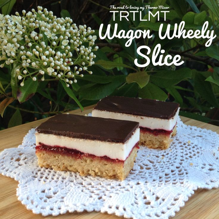Wagon Wheely Slice Base 140g plain flour 70g brown sugar 50g desiccated coconut 120g butter, cubed Jam 250g frozen raspberries 1 peeled and cored apple, approximately 100g 150g sugar Marshmallow 220g white sugar 75g cold water 1.5 tablespoon powdered gelatine 75g boiling water Ganache 150g dark chocolate 80g cream