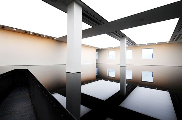 Credit: Linda Nylind The installation contains 8,000 litres of sump oil 20:50, from which the work takes its name