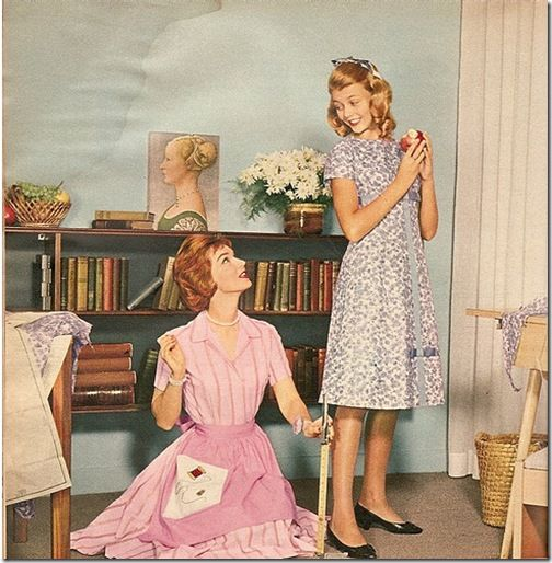 1959 colour photo of a mom measuring the hem length on a dress she's making for her daughter (from Miss Retro Modern's Flickr stream)