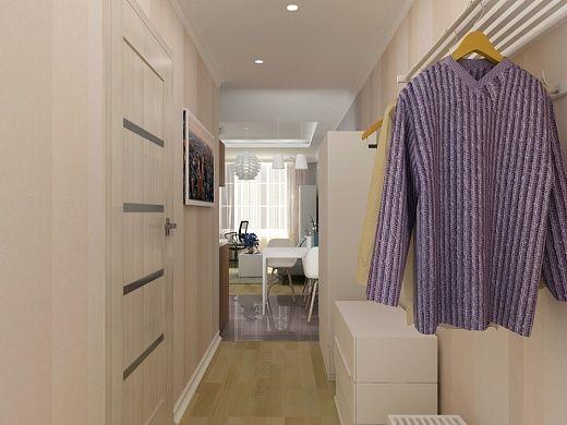 В прихожей достаточно места для хранения вещей: небольшой вместительный 2-дверный платяной шкаф, комод на 3 ящика, настенная вешалка, подставка для обуви. Все вместе элементы мебели позволяют размещать одежду и обувь жителей квартиры и гостей, не нарушая при этом общий порядок и гармонию пространства. Сама прихожая выполнена в цветах светлой бежевой палитры. Приковывающим внимание элементом декора является постер «Рассвет в мегаполисе» на стене напротив зеркала.