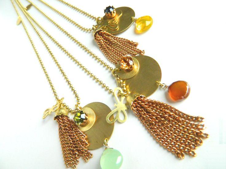 Planet neckclaces with butterfly. Natanè jewels, necklaces