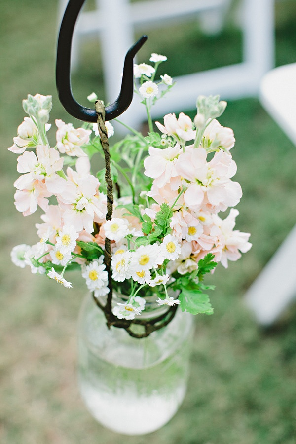 ceremony jars and flowers - hanging from hooks along the isle