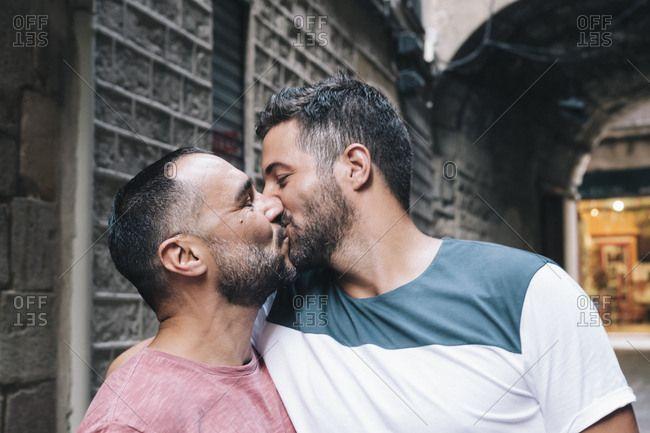 Portrait of two gay men kissing