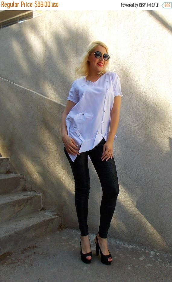 White asymmetrical blouse, perfect for summer and very versatile. It can be worn either as a classy (though a bit sophisticated) blouse or as an urban, out-of-the-box outfit. Can be combined with either heels or converses, jeans or black tight pants, as you see in the photos. Material: 95% cotton, 5% elastane Care instructions: Hand wash at 30 degrees.  The black pants in the photos: https://www.etsy.com/listing/231577440/black-leggings-black-rock-pants-black  The mod...