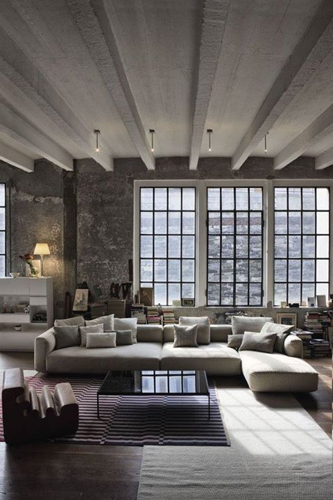 Warehouse Windows, minimalist style . Looks sooo cozy.  I like the ceilings, definitely a different style.