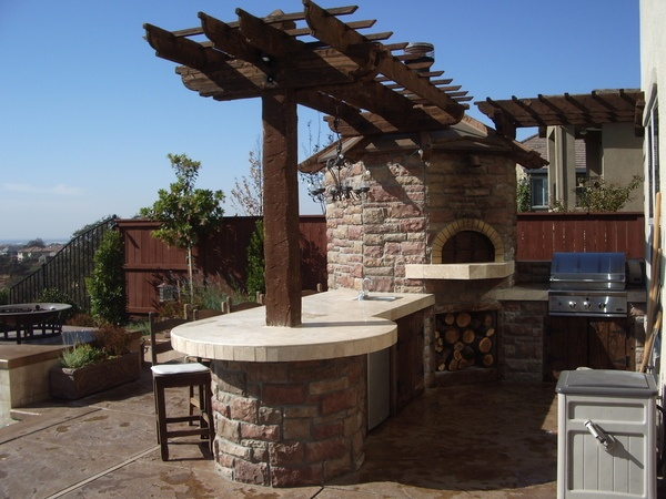 Outdoor kitchen with brick oven