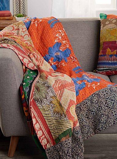 "The traditional Kantha throw made from unique and colourful pieces of recycled cotton.    Artisanally crafted in India   Each throw has a unique colour and pattern   Perfect as a blanket, furniture cover or even as a picnic cloth   60"" x 90"""