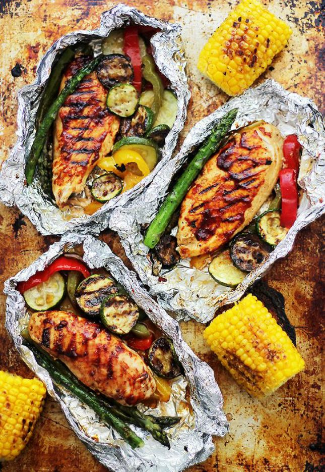 Grilled Barbecue Chicken and Vegetables in Foil:  15 Easy Foil Packet Meals Perfect for Campfire Cooking via Brit + Co