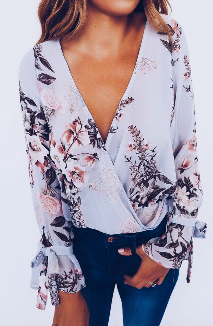 Love the deep V and bell cuff like sleeves! and of course I love most floral prints bc I like flowers!